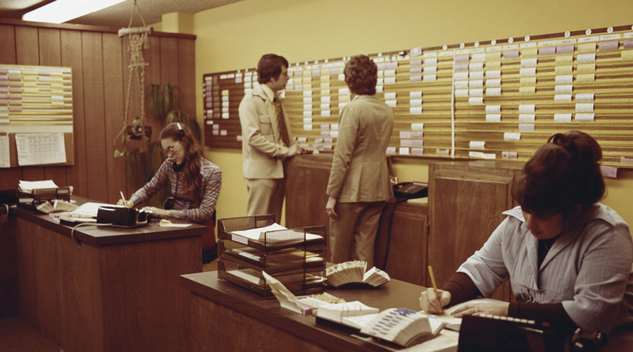 People working in 1970s office